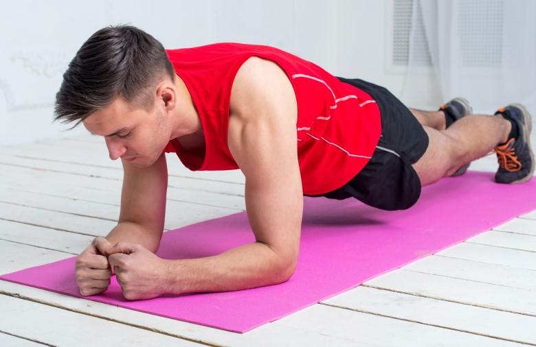 fitness training athletic sporty man doing plank exercise in gym or home concept exercising workout aerobic.